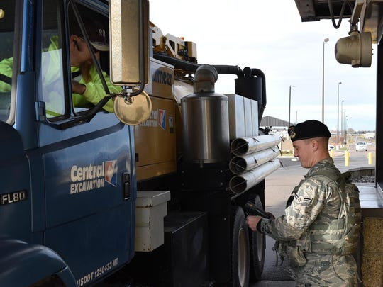 Airman 1st Class Dylan Kerns, 341st Security Forces Squadron member, checks identification cards for incoming visitors through the 10th Avenue North Access Gate at Malmstrom Air Force Base a few years ago. Montana is now Real ID compliant.