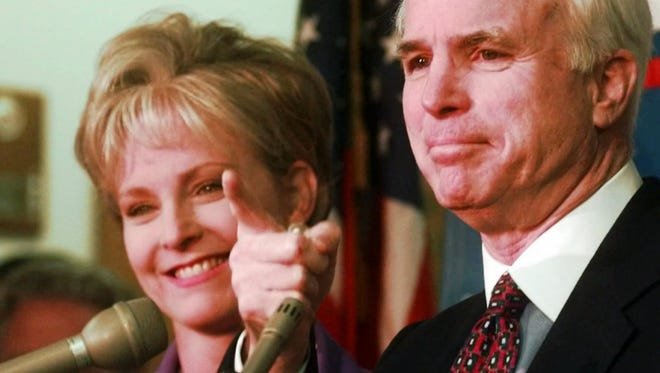 Sen. John McCain, R-Ariz., with his wife Cindy at his side, announces his plans to run for re-election to the Senate on April 17, 1998, in Phoenix.
