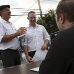Officiant Tony Smith, right, conducted the marriage ceremony between Leila Faucette, left, and Kristin Chervenak during the Marriage Celebration event held outside the Highlands Tap Room on Tuesday.