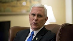 Vice President-elect Mike Pence speaks to members of