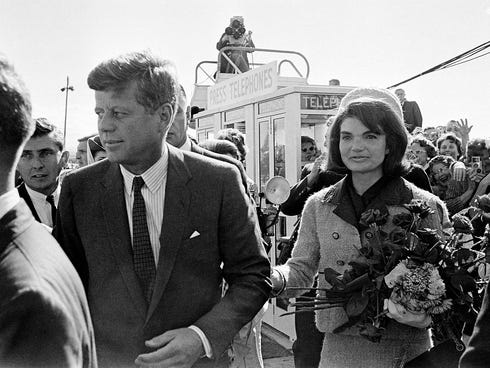 This Nov. 22, 1963 photo shows President John F. Kennedy and his wife Jacqueline Kennedy upon their arrival at Dallas Airport, shortly before President Kennedy was assassinated.