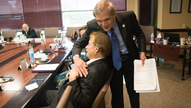 Lee Health Ceo and President, Jim Nathan hugs Jon Cecil after announcing he was stepping down as CEO after more than three decades.