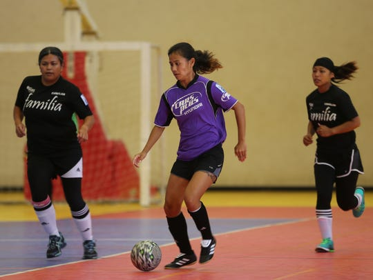 Hyundai's Arisa Recella escapes with the ball from