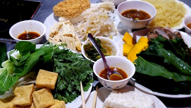 What could be more fun or pretty than a table of all-you-can-eat hot pot vegetables and custom sauces?