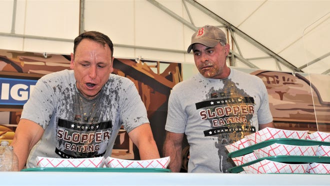 The two top-ranked competitive eaters in the world, Joey Chestnut, left, and Geoffrey Esper, moments after Esper set a world slopper-eating record in the PB&T Bank Pavilion at the Colorado State Fairgrounds.