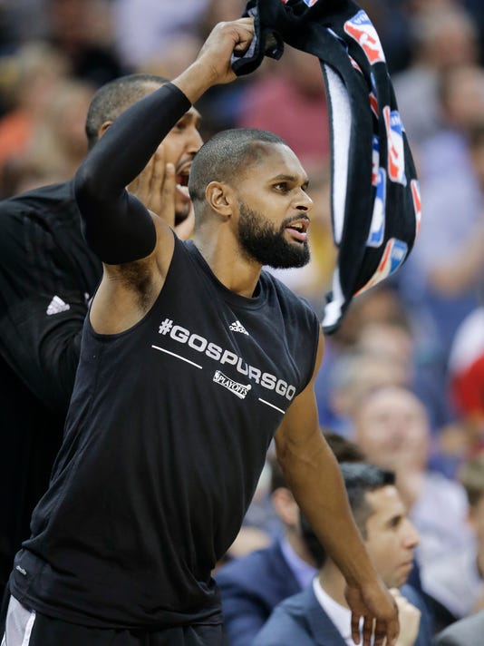 San Antonio Spurs guard Patty Mills cheers from the bench during the second half of Game 4 in a first-round NBA basketball playoff series against the Memphis Grizzlies Sunday, April 24, 2016, in Memphis, Tenn. The Spurs won 116-95 to sweep the series 4-0. (AP Photo/Mark Humphrey)