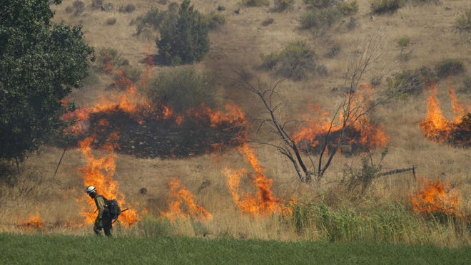 Multiple fire crews work to extinguish a wildfire in Leeds in this Spectrum Media file photo. Recent rains have doused early-season fire concerns in southwest Utah this year, but officials say it also means more fast-burning grasses to deal with later.