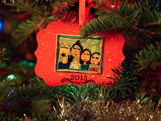 A family Christmas ornament hangs on the Insingas' Christmas tree in their home in Wilmington.