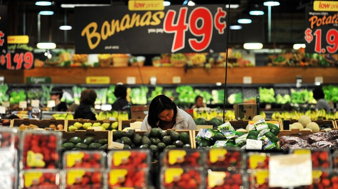 A woman shops at Wegmans in Fairfax, Virginia, in 2011. The supermarket chain plans to open a store off U.S. 202 in Pennsylvania, less than 3 miles from the Delaware line, before Thanksgiving 2015.