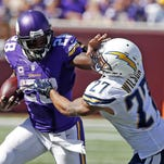 Minnesota Vikings outside linebacker Chad Greenway (52) runs for a touchdown after an interception of a pass from San Diego Chargers quarterback Philip Rivers (17) in the second half of an NFL football game in Minneapolis, Sunday, Sept. 27, 2015. (AP Photo/Andy Clayton-King)