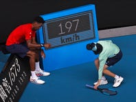 France's Gael Monfils serves to Austria's Dominic Thiem during their fourth round singles match at the Australian Open tennis championship in Melbourne, Australia, Monday, Jan. 27, 2020. (AP Photo/Andy Wong)