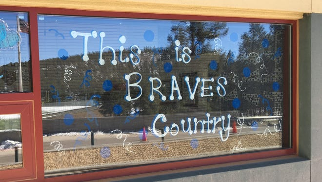 This motto shows on the window of the RMS spirit program office at the front of the school.