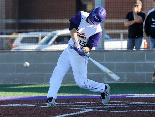 Wylie catcher Caleb Munton (25) turns on a pitch during