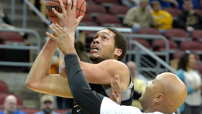 Purdue center A.J. Hammons, center, works on shooting drills with associate head coach Jack Owens during practice for an NCAA college basketball second round game in Louisville, Ky., Wednesday, March 18, 2015. Purdue plays Cincinnati on Thursday. (AP Photo/Timothy D. Easley)