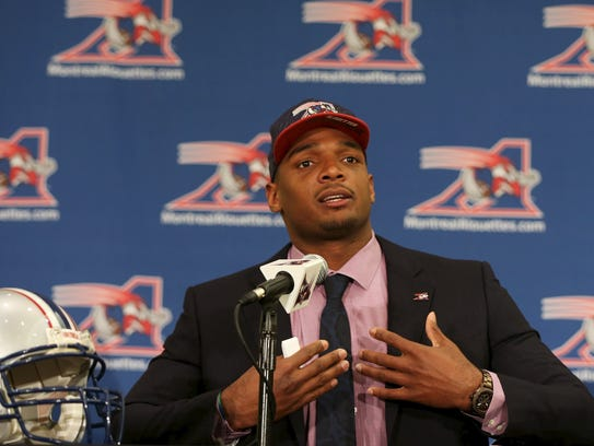 Newly signed defensive end Michael Sam gestures as