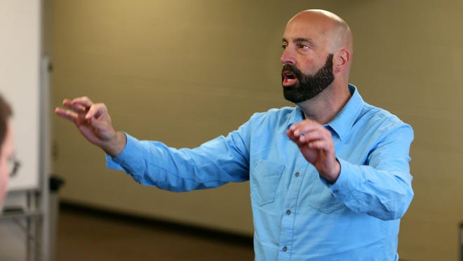 Jeff Wilson works with students on a concert that will feature international musical flavors.