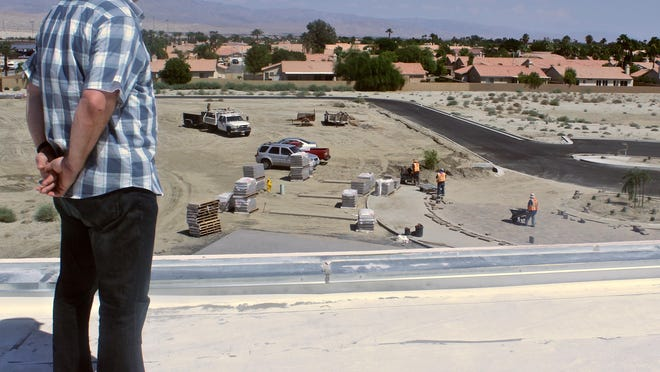 Pastor David Gilmore observes the construction of NorthGate Community Church from the roof of its new building in Cathedral City on Thursday. One of the oldest churches in the valley, NorthGate is on track to start services in October despite its main building still being under construction.