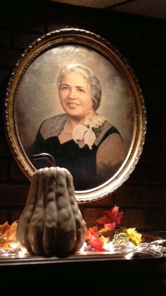 A portrait of founder Madeline Sparco hung over a mantle in the dining room at Madeline's Italian Restaurant in Wilmington.