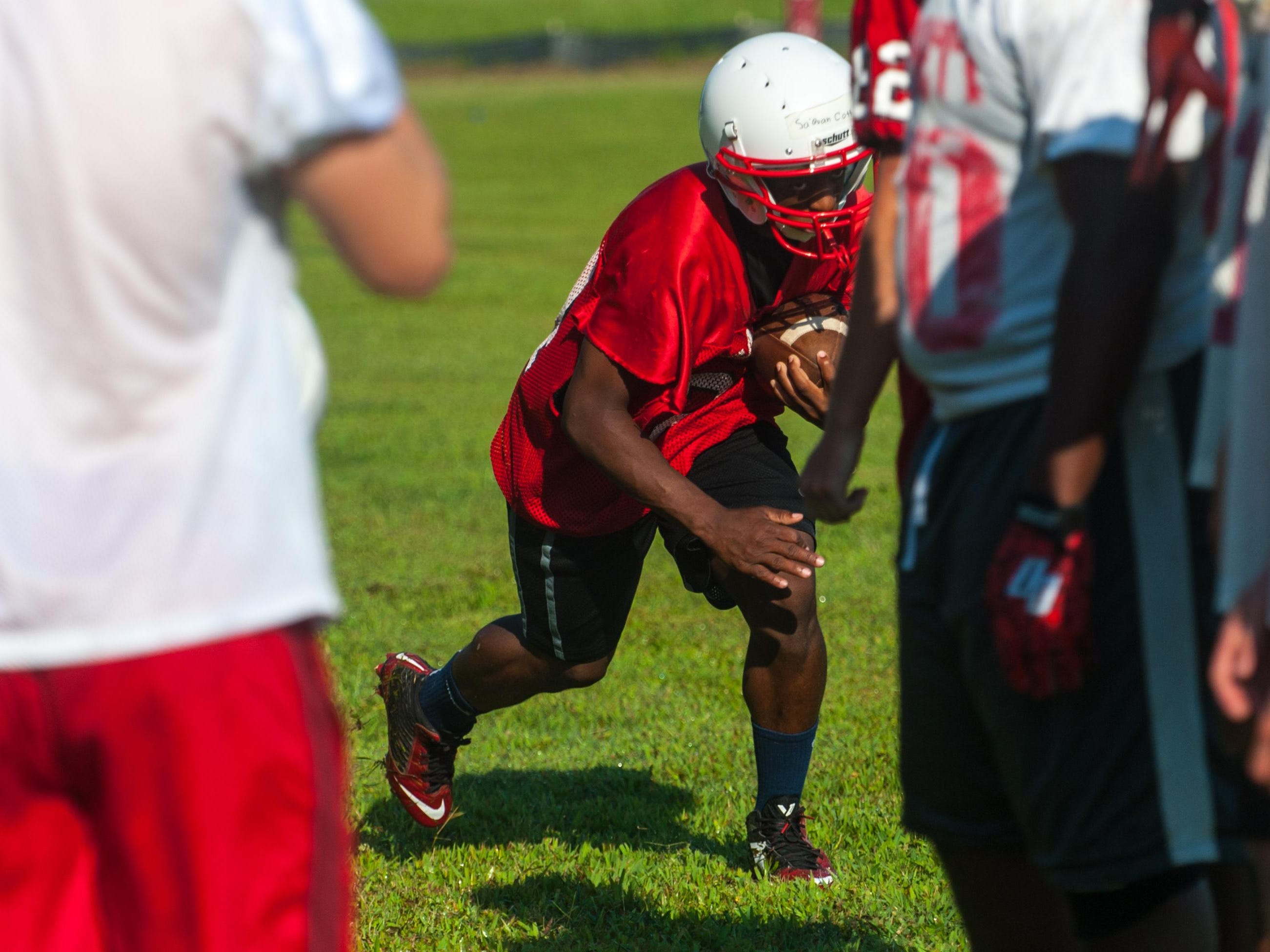 A James M Bennett running back works through drills on the second day of practice.