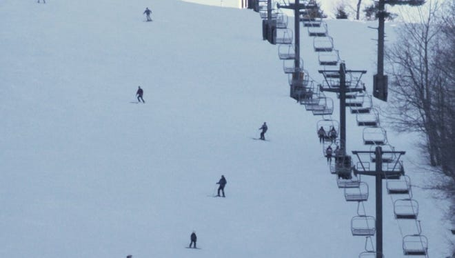 Skiers on the Lower Rocket trail at Bristol Mountain.