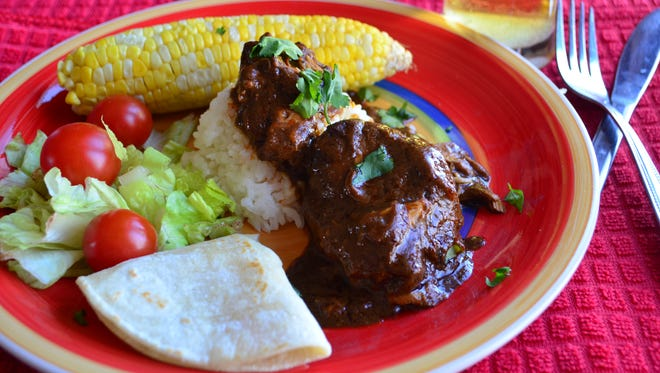 This mole sauce comes together in a slow cooker and produces tender chicken and a rich mole sauce.