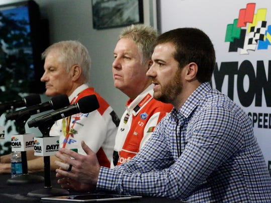NASCAR auto racing team owners Eddie Wood, left, Len Wood, center, and Jon Wood, answer questions during a news conference at Daytona International Speedway, Friday, Feb. 12, 2016, in Daytona Beach, Fla.  (AP Photo/John Raoux)
