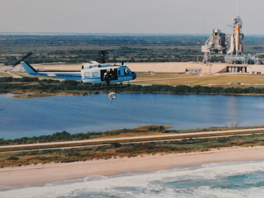 Jim Harrington  was the one who dropped the wreath from the helicopter into the ocean for the Challenger memorial held a few days after the accident. NASA PHOTO