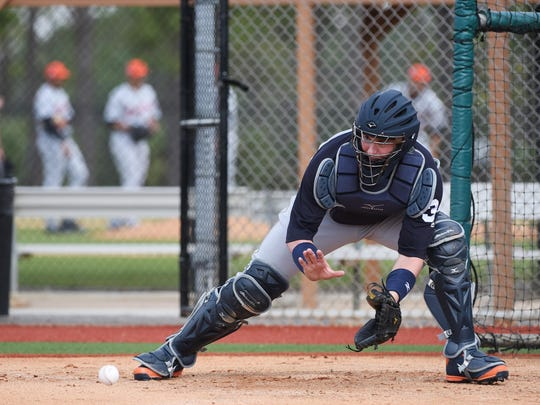 Tigers catcher James McCann fields a throw during home-plate drills during a workout in February in Lakeland, Florida.