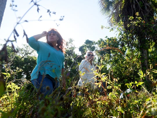 """Victoria Meissner (left) and Marcia Boyce, both of Vero Beach, make their way through thick brush as they take part in a search party on Wednesday, March 21, 2018, for a St. Lucie County woman who has been missing since Friday. Assunta """"Susy"""" Tomassi, who suffers from dementia, was last seen on foot along U.S.1 near Oslo Road Friday evening. The Indian River County Sheriff's Office helped in the search with a helicopter, K-9 units and all-terrain vehicles. To see more photos, visit TCPalm.com"""