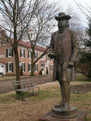 A statue of William Penn stands in New Castle, where the Quaker first landed in America. The city will honor him Saturday with a daylong celebration.