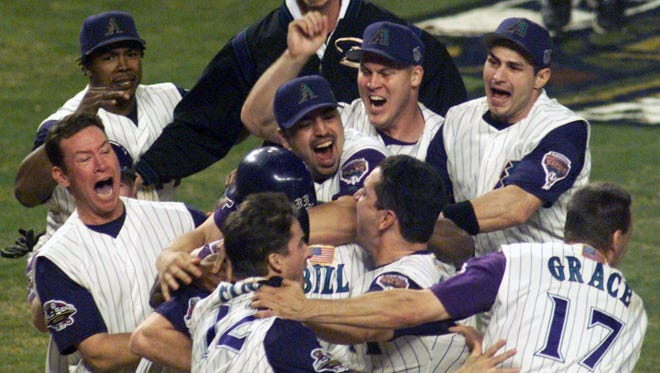 The Diamondbacks celebrate after scoring the winning run in the World Series against the New York Yankees in 2001.