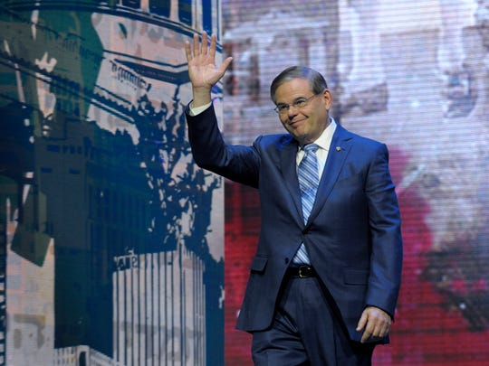 Senate Foreign Relations Committee Chairman Sen. Robert Menendez, D-N.J., waves as he arrives to address the American-Israeli Public Affairs Committee (AIPAC) 2013 Policy Conference at the Walter E. Washington Convention Center in Washington, Tuesday, March 5, 2013.
