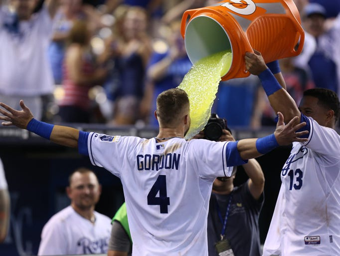 Aug. 26: Royals' Alex Gordon is doused with Gatorade by Salvador Perez after hitting a two-run walk-off home run against the Minnesota Twins during a baseball game Tuesday, Aug. 26, 2014, in Kansas City, Mo. The Royals won 2-1.