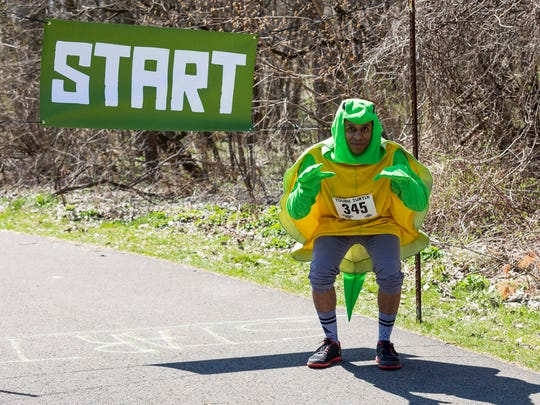 A participant at the 2016 Tough Turtle 5K, a fundraiser for the Ithaca Children's Garden.