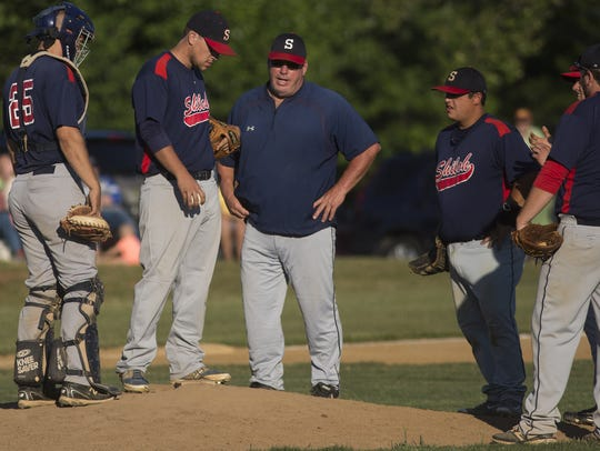 Shiloh manager Bubba Krout, center, speaks with relief