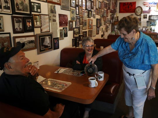 Klassique Kafe owner Millie Ellis pours coffee for longtime customer Sandi Palmer, and Palmer's father, George Sollender, Monday at the Restaurant in Redding.