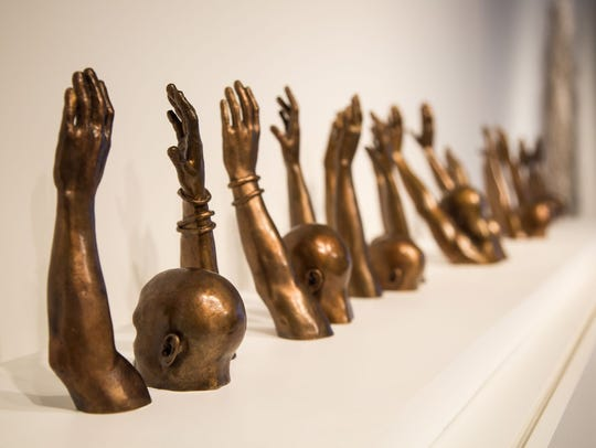 "Hank Willis Thomas (American), ""Raise Up,"" 2014, sculpture."