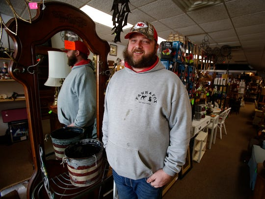 Mark McCaughey stands in his new store on the Indianola