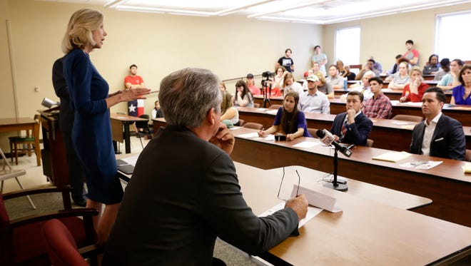 State District Judge Marilyn Castle speaks as her opponent for the Louisiana Supreme Court Judge Jimmy Genovese looks on during a debate at University of Louisiana at Lafayette Sept. 26, 2016.