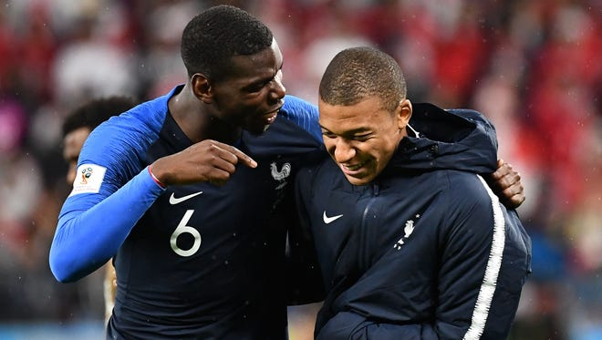 France's Paul Pogba and Kylian Mbappe.