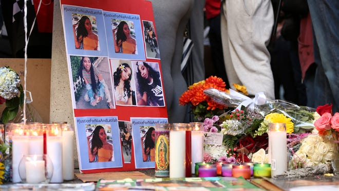 A memorial for 18-year-old Nia Wilson takes shape outside Bay Area Rapid Transit's MacArthur Station, Monday, July 23, 2018, a day after she was fatally stabbed on a platform at the station, in Oakland, California.