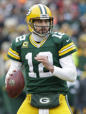 Green Bay Packers quarterback Aaron Rodgers (12) looks to pass in the fourth quarter.  The Green Bay Packers host the Dallas Cowboys during an NFC divisional playoff game Sunday, January 11, 2015, at Lambeau Field in Green Bay, Wis.  Dan Powers/P-C Media