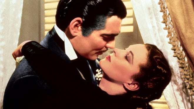 """This image released by Turner Classic Movies shows Clark Gable, left, and Vivien Leigh in a scene from """"Gone with the Wind,""""  the first film transmitted by TCM on April 14, 1994."""