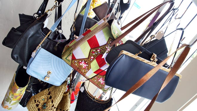 Designer and celebrity purses will be sold Friday during an auction to benefit Hope House in Richmond.