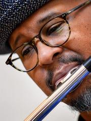 Flutist Michael Morton volunteers once a week to play