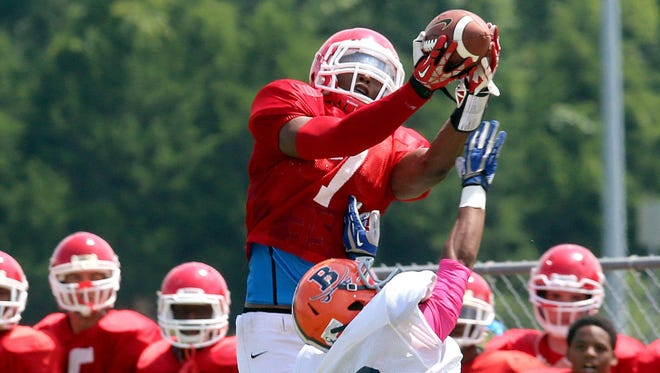 Oakland sophomore Jacoby Stevens goes up for a catch over a Beech defender a scrimmage.