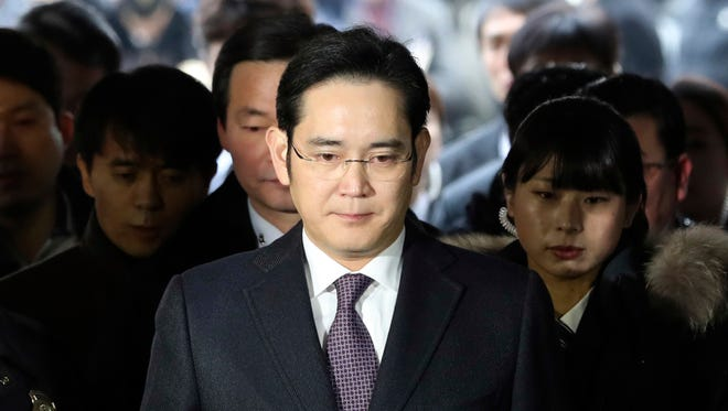 In this Jan. 18, 2017, file photo, Lee Jae-yong, front, a vice chairman of Samsung Electronics Co. arrives for the hearing at the Seoul Central District Court in Seoul, South Korea.