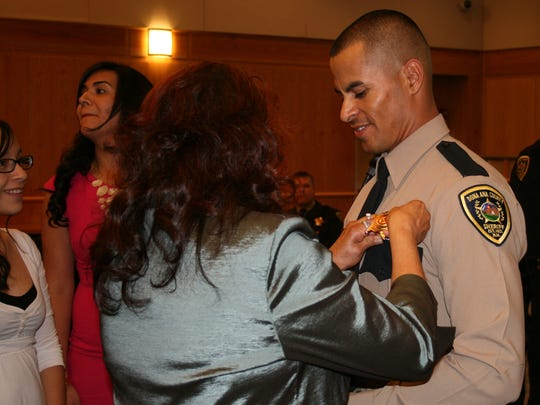 Jose Chavez is pinned during his graduation from the