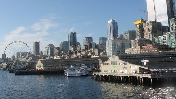 Seattle's waterfront bustles with entertainment options.