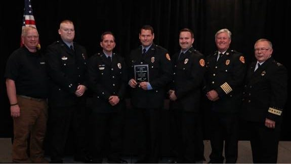 Jason Webb, second from left, Brian Brandon, Kevin Hunt, Alan Fulwood and Chief Rocky Garzarek of the Franklin Fire Department receive an award from representatives of the National Association of Emergency Medical Technicians.